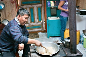 This is our home stay father, cooking.